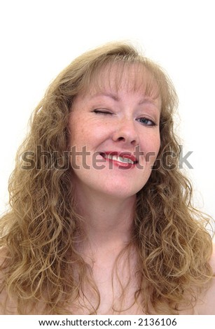Attractive caucasian woman winking and smiling. Isolated on white. - stock photo