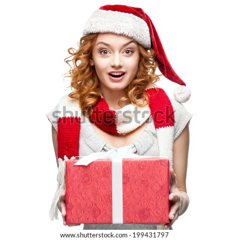 attractive cheerful young caucasian red woman in santa hat holding gift isolated on white - stock photo
