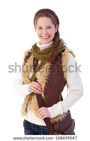 Attractive college student dressed up warm, smiling at camera. - stock photo