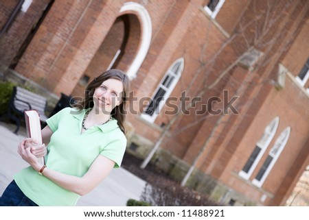 Attractive college student on a college campus - stock photo