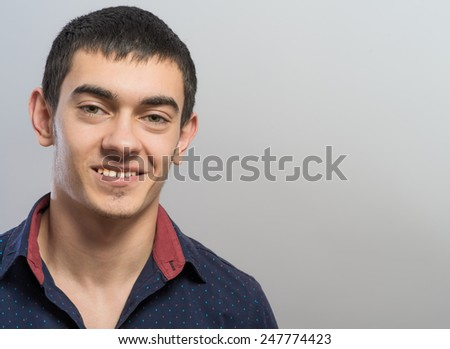 attractive confident young man smiling  - stock photo