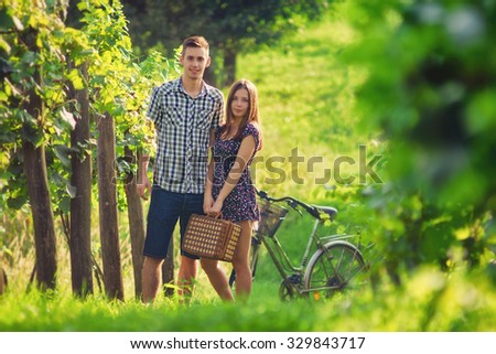 Attractive Couple Enjoying Romantic date in the Countryside, with custom white balance and color filters - stock photo