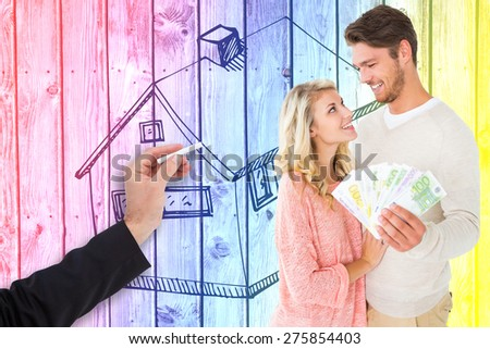 Attractive couple flashing their cash against digitally generated grey wooden planks - stock photo