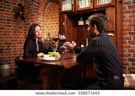 Attractive couple in a restaurant - stock photo