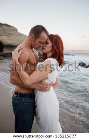 Attractive Couple on the Beach - stock photo