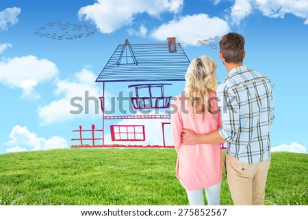 Attractive couple standing and looking against blue sky over green field - stock photo