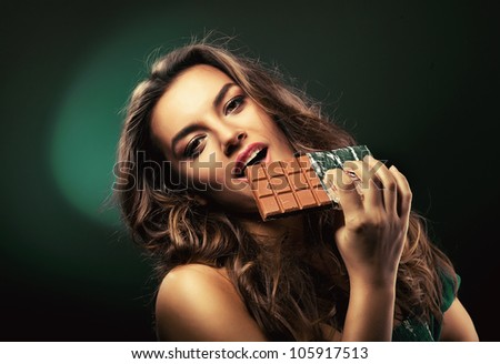 attractive cute woman with chocolate - stock photo