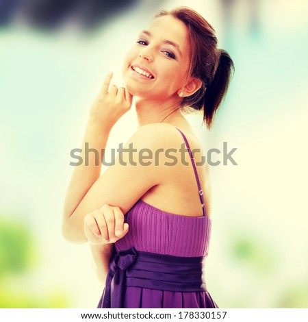 Attractive dancer girl in violet classic dress - stock photo