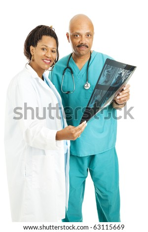 Attractive doctors holding a CT scan.  Isolated on white. - stock photo
