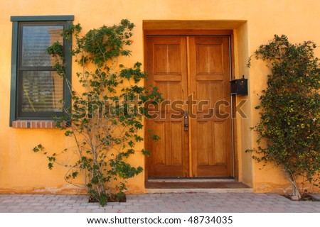 attractive door and plants in Tucson's Old Barrio - stock photo