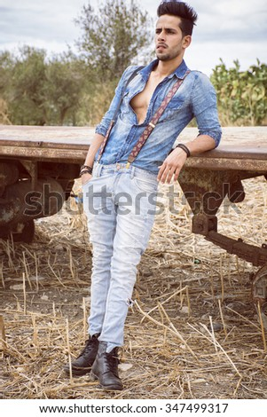 attractive fashion farmer take a models pose. - stock photo