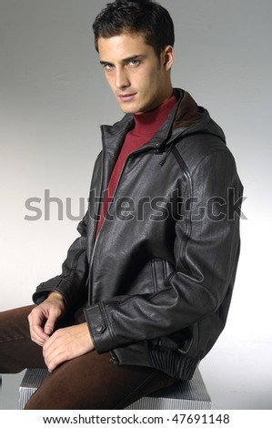 attractive fashion man shot in studio - stock photo