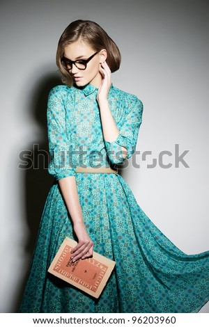 Attractive fashion model on gray background. - stock photo