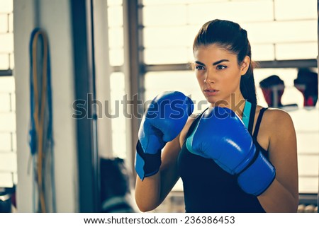 Attractive Female Boxer At Training - stock photo