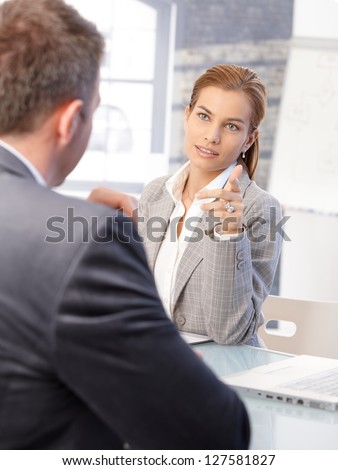 Attractive female hr manager interviewing male applicant in bright office. - stock photo