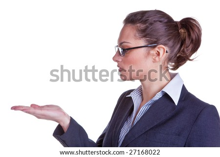Attractive female in business suit with looking at her hand, ideal shot for product placement. Isolated on white background. - stock photo