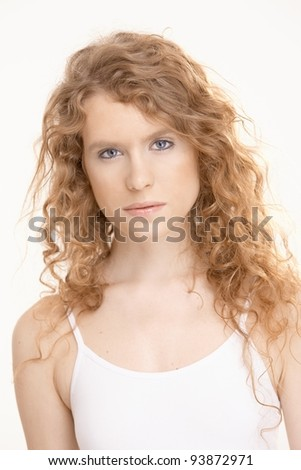 Attractive female in gym suit looking at camera.? - stock photo