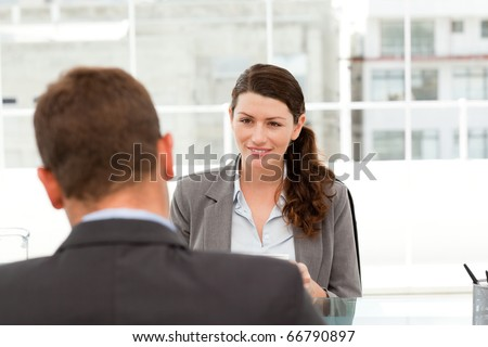 Attractive female manager during a interview with a businessman in her office - stock photo