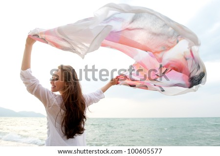 Attractive Female on the Beach - stock photo
