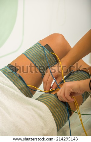 Attractive female patient receiving electro threrapy beauty treatment - stock photo