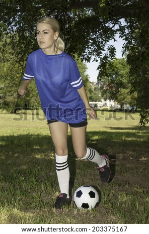 attractive female soccer player - stock photo