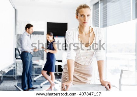 Attractive female worker in office - stock photo