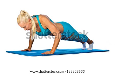 attractive fit blond woman push up exercise - stock photo