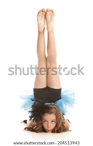 Attractive, fit preteen performing a dance move.  Isolated on white. - stock photo