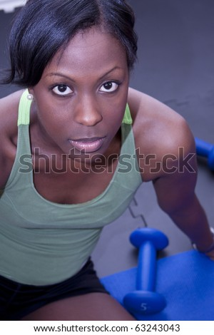 Attractive fitness and workout woman - stock photo