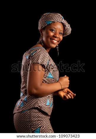 Attractive Ghanese african woman showing a dance in her traditional national costume - stock photo