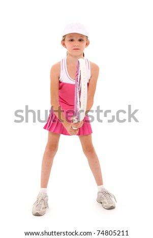 Attractive girl child playing tennis in pink uniform over white background with clipping path. - stock photo