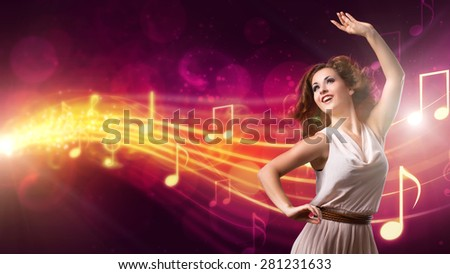 attractive girl dancing to music - stock photo
