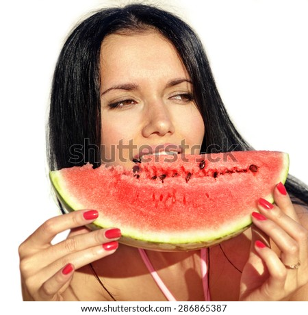 attractive girl eats a slice of ripe water-melon - stock photo