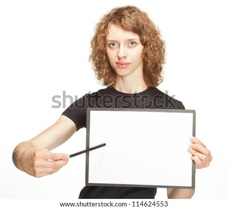 Attractive girl holding clipboard with blank paper and pointing at it, white background - stock photo