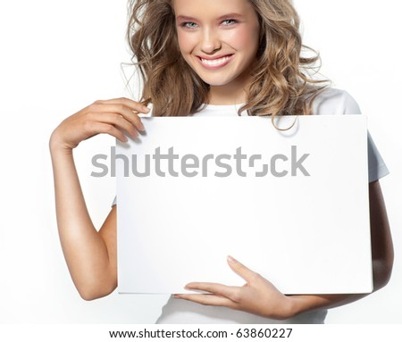 attractive girl holding white page - stock photo