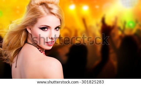 attractive girl in a club - stock photo
