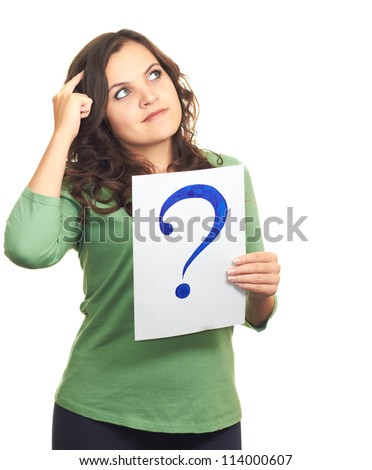 Attractive girl in a green shirt, holding a sheet of paper with a big question mark, and looks to the upper-left corner. Isolated on white background - stock photo