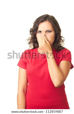 Attractive girl in a red shirt from the stench covers the nose. Isolated on white background - stock photo