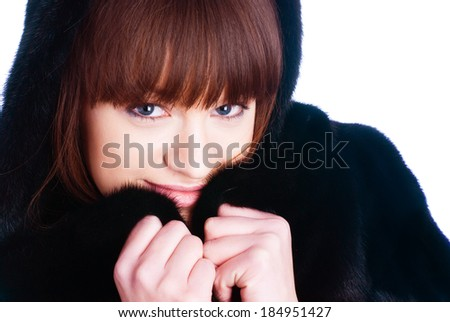 Attractive girl in black fur coat at isolated background - stock photo