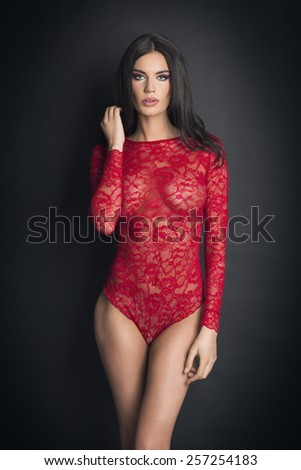 Attractive girl in sexy red lingerie - stock photo