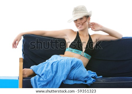 attractive girl laying on beach sofa isolated over white - stock photo