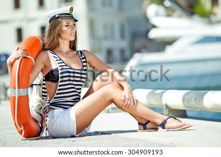 Attractive girl on a yacht at summer day - stock photo