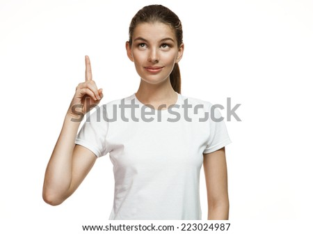 Attractive girl pointing up showing copy space / Gorgeous girl in plain white T-shirt. Mixed race Latina Caucasian young woman gesticulating - isolated on white background.  - stock photo