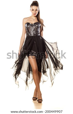 attractive girl posing in evening dress - stock photo