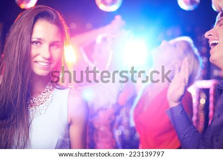 Attractive girl posing on dance-floor in nightclub  - stock photo