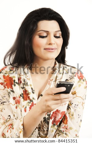 Attractive girl sending or receiving a message - stock photo