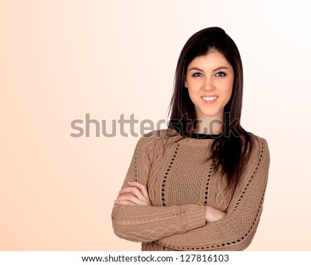 Attractive girl smiling isolated on a orange background - stock photo