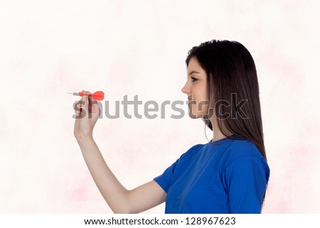 Attractive girl smiling throwing a dart isolated on a white background - stock photo