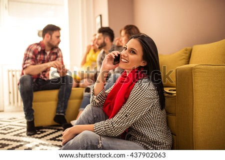 Attractive girl talking on a mobile phone. - stock photo