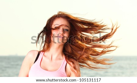 Attractive girl wind in hair Young woman on background of sea sky - stock photo